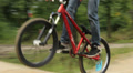 Tracking shot of BMX bicycle in competition racing to win HD Footage