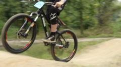 BMX bicycle challenge, rider struggling to finish race first - stock footage
