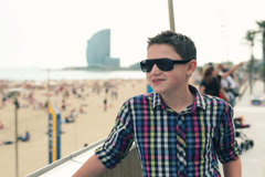 Happy young teenager looking around near barceloneta beach NTSC Stock Footage