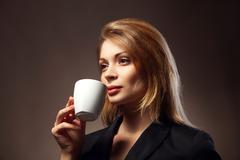 Beautiful Girl Drinking Tea or Coffee - stock photo