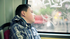 Sad young teenager riding bus in the city HD Stock Footage