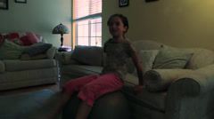 Little Girl Plays on Giant Exercise Ball Stock Footage