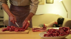 Cannibal chopping up his victim, humour - stock footage