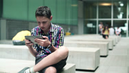 Stock Video Footage of Young teenager with tablet computer in urban environment HD