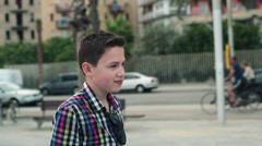 Happy young teenager walking in the city HD Stock Footage