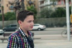 Happy young teenager walking in the city NTSC Stock Footage