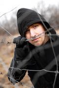 hooded man - stock photo