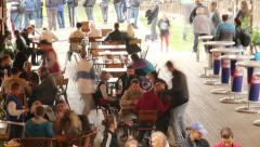 Public place cafe tables timelapse, eating people, drinking men Stock Footage