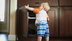 Baby Opening Cupboard - stock footage