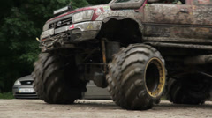 Moving large big-foot vehicle completely in mud and dirt wheels Stock Footage
