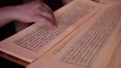 Close up of ancient Buddhist script being read inside in Gompa. Stock Footage
