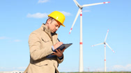 Engineer at Work in a Wind Turbine Power Station Stock Footage