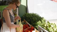 Young woman shopping for fresh vegetables Stock Footage