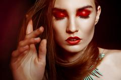 Beautyful woman with creative make-up over dark Stock Photos