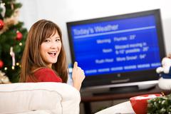 Christmas: woman happy about winter forecast Stock Photos