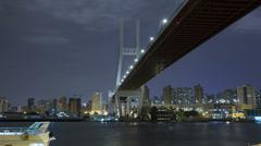 Time lapse: shanghai urban landscape, nanpu bridge crossing the river Stock Footage