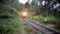 Train exiting tunnel and crossing bridge Stock Footage