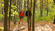 Stock Video Footage of Hiking through colorful fall foliage, medium shot.