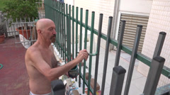 painting the fence - stock footage
