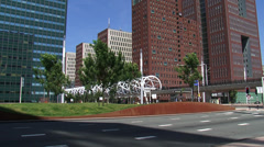 Lightrail crossing RandstadRail viaduct in business center The Hague Stock Footage
