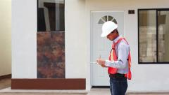 Male Building Inspector Taking Notes Stock Footage