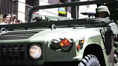 Soldier driving a humvee in city Stock Footage