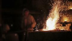 Blacksmith forging a iron sword - stock footage