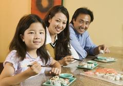 Family Eating Sushi Together portrait - stock photo