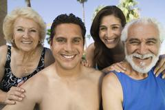 Mid-adult couple and senior couple outdoors front view portrait. - stock photo
