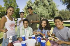 Family Having Food On A Picnic Stock Photos