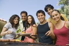 Stock Photo of Group Portrait Of Casual Friends Enjoying A Barbecue