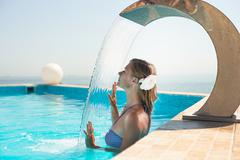 Attractive young woman refresh in pool Stock Photos