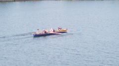 Rowing crew traveling down the River Thames on a sunny day Stock Footage