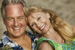 Middle-Aged couple outdoors (close-up) (portrait) Stock Photos