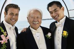 Groom with father and best man outdoors (portrait) - stock photo