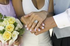 Brides hands and wedding ring (close-up) - stock photo
