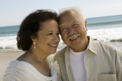 Stock Photo of Senior Newly wed couple at beach (close-up)