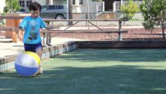 Little Boy Runs and Kicks Beach Ball - stock footage