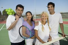 Four Mixed Doubles Tennis Players At Net - stock photo