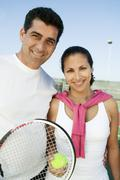 Mixed doubles Tennis Players standing on tennis court portrait Stock Photos