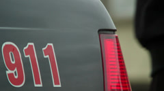Police 911 car steel part, emergency phone on security vehicle - stock footage