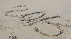 New Year numbers 2013 washing from sand by sea water Stock Footage