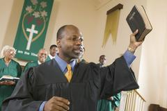 Preacher Preaching the Gospel in church Stock Photos