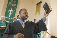 Stock Photo of Preacher Preaching the Gospel in church