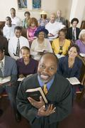 Preacher and Congregation portrait high angle view - stock photo