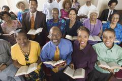 Church congregation sitting on church pews with Bible portrait high angle view - stock photo