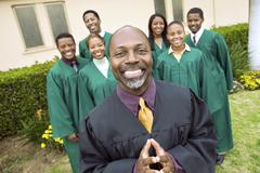 Preacher And Choir Standing In Front Of Church Stock Photos