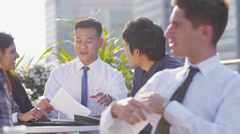 Young attractive asian business team in open air meeting in the city - stock footage