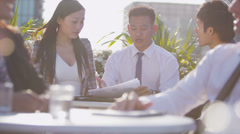 Young asian business team in open air meeting in the city shake hands on a deal - stock footage