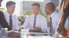 Mixed ethnicity business team in open air city meeting shake hands on a deal Stock Footage